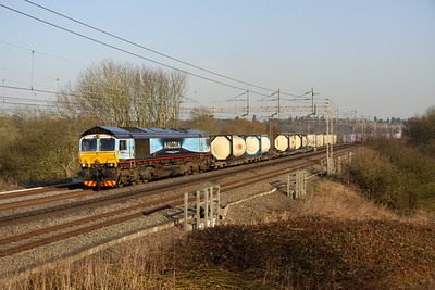 5 March. Uniquely liveried 66434 takes a full load in the form of 4M71 1129 Purfleet - Daventry past Chelmscote.