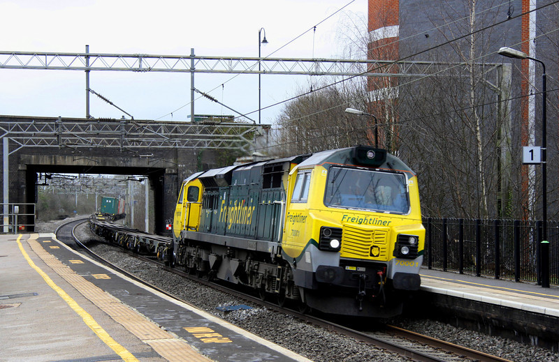 1 March. One on one on one. With the slow lines shut due to the wires being down, pioneer 70001 PowerHaul takes a lightly loaded 4M54 1010 Tilbury - Crewe through Wolverton.