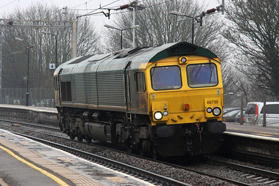 7 March. Miserable weather sees GBRf operated 66739 still in unbranded Freightliner green passing through Wolverton working as the 0Z06 Longport - Wembley and eventually Eastleigh Works.