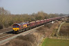 4 March. EWS liveried 66154 takes the 4D12 1322 Didcot Power Station - Avonmouth empty coal past Denchworth.
