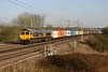 5 March. GBRF 66735 takes 4M23 1045 Felixstowe - Hams Hall past Chelmscote. She was the former DRS operated 66403.