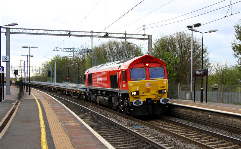 4 May. Recently repainted pioneer, 66001 passes Wolverton atop the 6R06 1646 Crewe Basford Hall - Wembley Central engineers. 66170 was on the rear.
