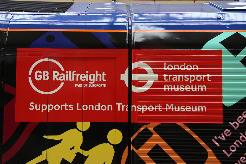 5 Nov. The red bodyside panel now supporting the affiliation between GB  Europorte and the London Transport Museum as applied to 66718.
