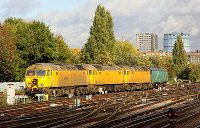 5 Nov. Having been displaced from Broxbourne RHTT duties, 57312 Peter Henderson + 57301 + 57306 lead the Arlington translators 975974 Paschar + 975978 Perpetiel past Clapham Junction with the 0958 Peterborough GBRf - Eastleigh move.