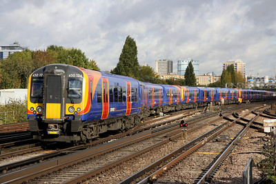 5 Nov. Desiro 450124 leads a twelve car ECS formation into Clapham Junction Yard.
