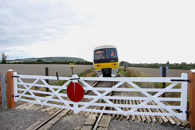 5 Oct. With the freshly painted gates secured, 165001 heads away from camera at Horsenden Lane Crossing with the 1542 Princes Risborough - Chinnor.