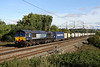 4 Oct. Former Fastline shed 66301, leads the 4M71 1129 Purfleet - Daventry sugarliner through Chelmscote.