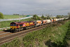 12 April 2014. Graffitti stone at Castlethorpe as tagged 66057 passes with the 6M34 1240 Acton Yard - Peak Forest empties.