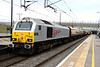 5 April 2014. The annual pilgrimage to Aintree for the Grand National sees Jubille skip 67026 Diamond Jubilee on the rear of the 0804 London Victoria - Runcorn. Sister 67024 was leading to Merseyside.