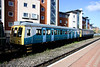 18 April 2014. Previously used by Arriva on the Cardiff Bay - Cardiff Queen Street shuttles debranded 121032 (55032) stands in the station sidings at Aylesbury with sister 960014 (55022).