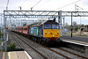 12 April 2014. XP64 loco 47853 RAIL EXPRESS rattles at speed through Bletchley with the 5Z67 1600 Crewe Holding Sidings - West Ealing Loop ECS. Note Fugly 70005 taking a passing interest from the stone terminal. She would later work the drain train to Hillmorton Junction near Rugby.