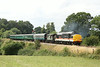 2 August 2014. Evoking memories of IC liveried 37's in pairs on Highland main line sleeper services, 37254 Driver Robin Prince M.B.E. accelerates past Lealands with a mixed consist forming the 2T70 1315 Eridge - Tunbridge Wells West.