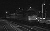 18 December 2014. Monochrome movement.  A very high ISO of 3200 freezes 56312 Jeremiah Dixon hauling 86702 Cassiopeia + 86213 Lancashire Witch passing Wolverton working the 0Z86 Barrow Hill - Willesden TMD. It is rumoured the AC locos are to be evaluated for use on sleeper ECS moves out of Euston.