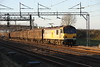 13 December 2014. The low setting sun sees 92019 Wagner pass Soulbury in charge of the 6O67 1405 Daventry - Dollands Moor.