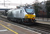 20 December 2014. With 68014 having travelled south, sister 68011 heads north through Wolverton working the 0Z69 Wembley LMD - Crewe Gresty Bridge..