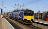 22 February 2014. Merseyside sun as 150140 arrives at Liverpool South Parkway working the 1027 Liverpool Lime Street - Manchester Oxford Road.