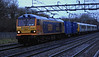 1 Jan 2014. Happy New Year and a new delivery to boot. Abysmal weather with the light dead and the rain lashing down as the sole GBRf Europorte 92, 92032 Railway Division IMechE hauls brand new 350404 + 350405 past Bradwell on the 6X50 1230 Dollands Moor - Ardwick TMD. Note that 350404 has suffered a graffitti  attack whilst on mainland Europe.