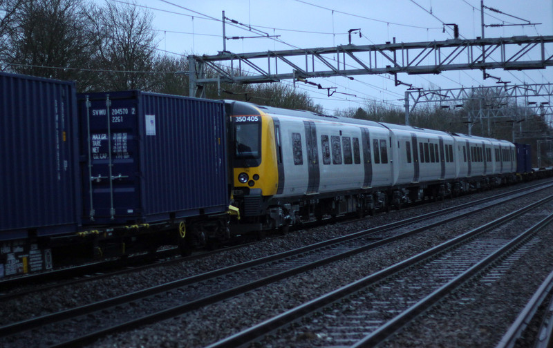 1 Jan 2014. Free from graffitti, 350405 is seen at the rear of 6X50 passing Bradwell. The 350/4's are all on delivery for use by Trans Pennine Express on journeys from Manchester to Scotland.