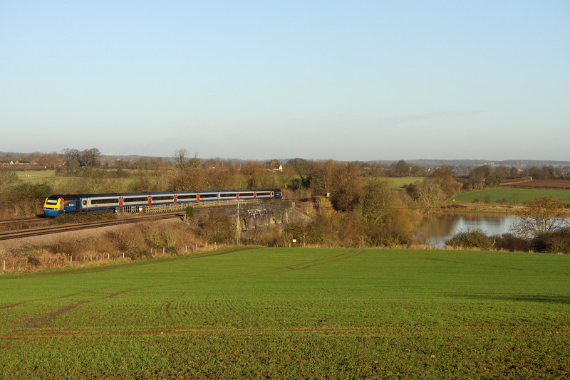11 Jan 2014. EMT HST 43050 passes Oakley and a severely swollen Great Ouse with the 1B23 0634 Leeds - St. Pancras International.