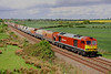 6 May 2014. Foinaven flying ! 60079 in DBS house colours passes Husborne Crawley with the 6H10 1008 Bletchley - Peak Forest empties.