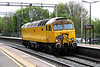 2 May 2014. A splash of yellow as bodysnatcher 57305, the former 47822 complete with DRS London On a Mission headboard flies south at Wolverton working the 0Z57 1035 Crewe Gresty Bridge - Old Oak Common HST depot.