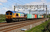 6 May 2014. Rainbow warrior 66720 passes Soulbury with 4M23 1045 Felixstowe - Hams Hall intermodal.