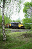 2 May 2014. A different viewpoint of 56312 and 66545 through the trees at Calvert.