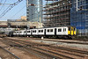 8 September 2014. Plain white but with blue doors 317666 leads 317888 past Stratford as the 5H46 1625 Ilford depot - Liverpool Street ECS working.