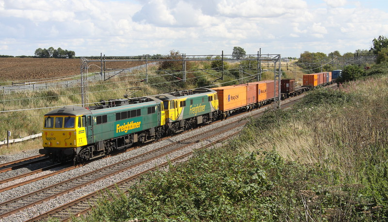 28 August 2015. Displaying the old and new Freightliner colours, 86610 + 86622 pass Castlethorpe with the 4M54 1010 Tilbury - Crewe. 86610 as E3104 will celebrate her 50th year of service since introduction in October 2015 whilst 86622 is celebrating her 50 years of service since introduction this month.