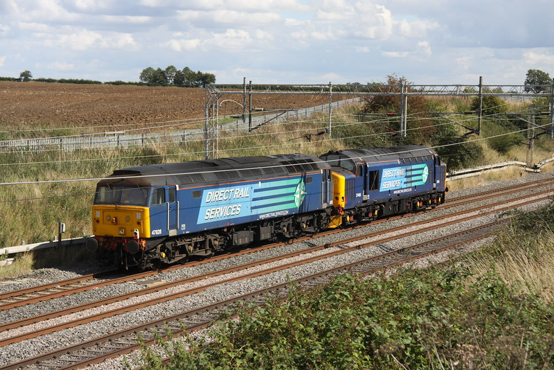 28 August 2015. Anglia bound......or not. 37405 and 47828 head past Castlethorpe heading south as the 0Z37 1100 Crewe Gresty Bridge - Norwich. Things did not quite go to plan and the working was truncated at Ilford.