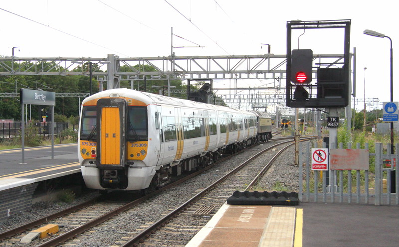 23 August 2015. Having dropped a member of traincrew 57312 Solway Princess - 375309 take the line to Bedford and the MML at Bletchley. Note there are also two class 350's, two Freightliner 66;s and a LM 153 visible.