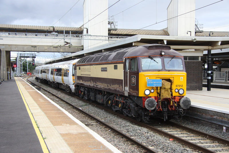 23 August 215. Originally due to have run the previous day, 57312 Solway Princess, sporting a Rail Operations Group headboard draws to a stand at Bletchley conveying SE 375309 working as the 5O58 1450 Ramsgate TMD - Derby Litchurch Lane.