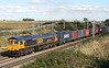 21 August 2015. GBRf 66756 escapes from the shadows seen passing Castlethorpe with the later than normal pathed 4M23 1310 Felixstowe - Hams Hall.