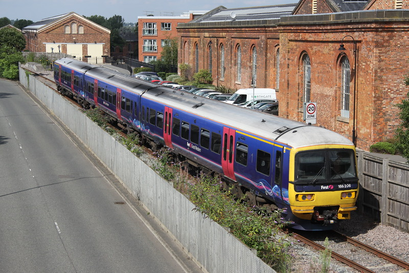 22 August 2015. With 166205 having been despatched back to Reading depot from Wolverton earlier in the day, sister unit 166206 will be the next to get the 'Wolverton treatment' and is seen arriving on the works having worked up from Berkshire as the 5M65 1333 ex Reading.