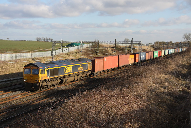 6 February 2015. Named after GBRf employee Sarah Whurr to mark her 40th birthday, appropriately numbered 66740 Sarah passes Castlethorpe with the 4M23 Felixstowe - Hams Hall.