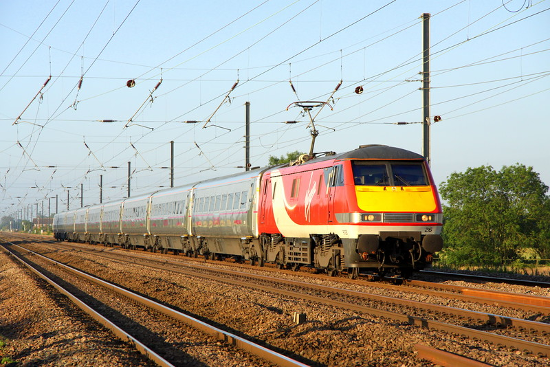 3 July 2015. Glorious morning sun greets 91126 working the first northbound express of the day as she powers the 1D01 0550 King's Cross - Leeds past Holme Green Crossing, just south of Biggleswade.