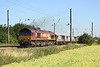 3 July 2015. 66127 picks up speed as it passes Holme Green having just left the Plasmor sidings at Biggleswade with the 6L69 0538 Peterborough Yard - Bow