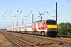 3 July 2015. A full Virgin East Coast liveried rake sees 91129 head north at Holme Green with the 1S06 0730 King's Cross - Edinburgh.