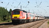 3 July 2015. The first pair of Virgin East Coast liveried HST power cars have been released into traffic, namely 43311 and 43312. The latter is seen heading south at Holme Green leading the 1B81 0730 Lincoln Central - King's Cross.