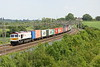 5 June 2015. Taken from Soulbury Road overbridge, London Underground emblazoned 66721 Harry Beck looks remarkably clean as she heads north on 4M23 1046 Felixstowe - Hams Hall.