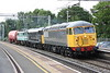 18 June 2015. With a combined loco age of 139 years, UK Rail 56081 hauls recently repainted and named DC Rail 31601 Devon Diesel Society + Anglia Railways liveried 86246 + TEA 89011 through Wolverton working as the 6Z31 1258 Long Marston - Willesden TMD. 56081 is on hire to DC Rail as they are experiencing a loco shortage at present. The 86 is to be used as a source of spares and will help facilitate the return to traffic of 86259 which has been laid up with faulty wheelsets.