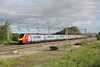 30 May 2015. Double voyagers as 221102 Christopher Colombus + 221104 Sir John Franklin race south at Gordon's Lodge on the 1A04 0538 Lancaster - Euston.