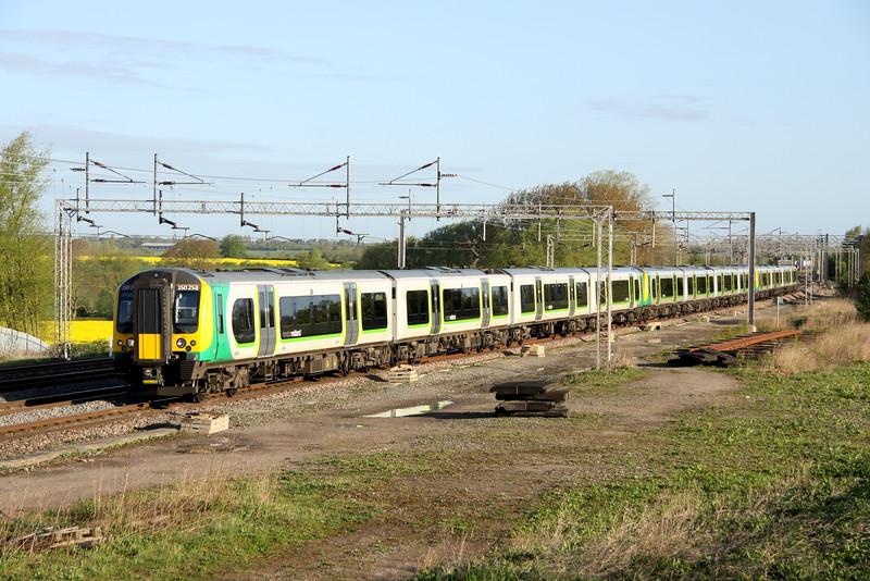 4 May 2015. Twelve car desiro as 350258 + 350130 + 350254 pass Gordon's Lodge on the 2W82 0700 Northampton - Euston.