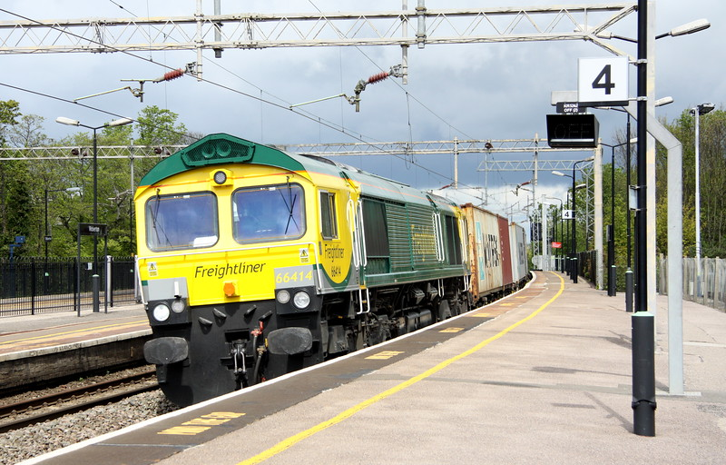 9 May 2015. Former Stobart James the Engine now sporting full Freightliner Powerhaul colours rattles south through Wolverton atop the 4L90 0830 Lawley Street - Felixstowe.