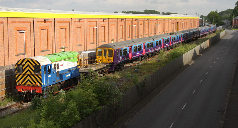 24 May 2015. Wolverton Works resident 08649 Bradwell is seen meandering along McConnell Drive in Wolverton with 319377 + 319378 + 319429 having arrived under their own power as the 5M80 1142 Bedford Carriage Sidings - Wolverton Centre Sidings.
