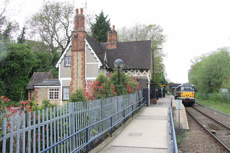 8 May 2015. Oh to lose that palisade fencing. Time travel at Fenny Stratford with 31190.