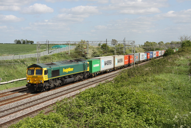 16 May 2015. Standard Freightliner fare as 66569 leads the 4M20 1014 Felixstowe - Lawley Street past Castlethorpe.