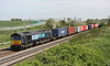 15 May 2015. DRS liveried but Freightliner operated 66420 passes Castlethorpe with the 4M88 0932 Felixstowe - Crewe Basford Hall.