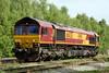15 May 2015. 66035 is seen at Calvert running round her train, the 6M48 0916 Willesden Euroterminal - Calvert spoil .