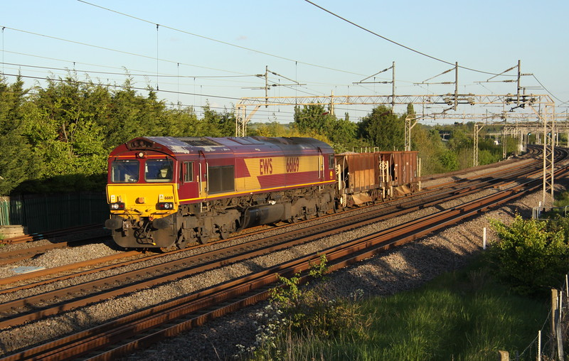 20 May 2015. With the loco being longer than the payload, 66169 takes two Seacows, 980195 + 980076 past Stoke Hammond on the 1842 Willesden - Bescot.